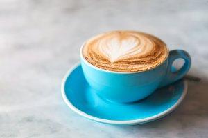 Fresh coffee with heart love foam in