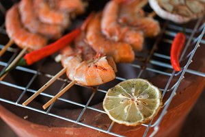 Fresh shrimps on barbecue outdoors
