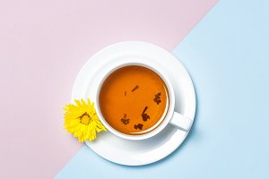 Cup of tea with chrysanthemum