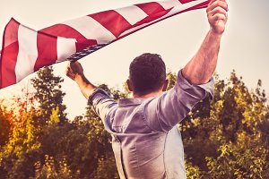 Attractive man holding US flag