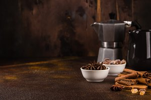 Coffee pot with spices on brown