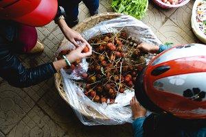 Buying rambutans in Asian market