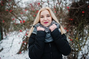Blonde girl posed at winter snowy da