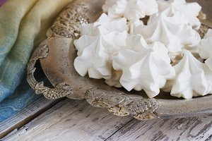 White meringue on plate served in elegant style.