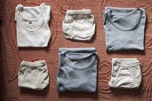 Benigno underwear over bed coverlet
