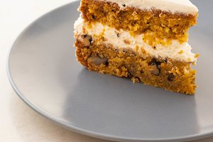 Slice of carrot cake with cream