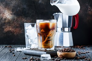 Coffee with ice and milk, brown tabl