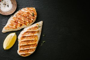 Grilled chicken breast served on bla