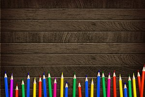 Color pencil on wooden background