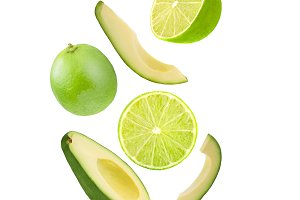 Falling avocado and lime isolated on