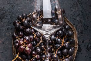 Wine glass on grapes