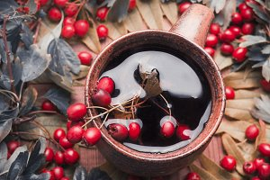 Autumn tea with red berries