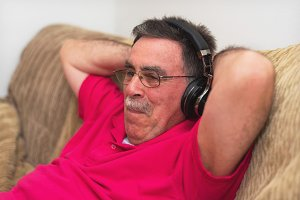 Relaxed Senior man in headphones