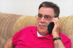 senior man happy talk on the phone