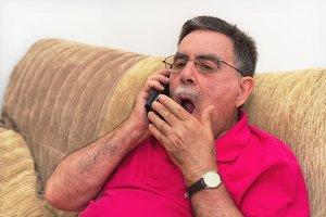Portrait of a senior man yawning