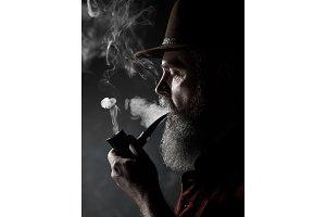 dramatic portrait of senior smoking