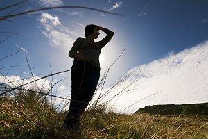 peaceful  woman silhouette in field