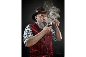 dramatic portrait of senior smoking