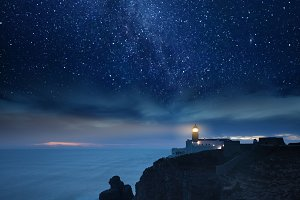 Lighthouse under starry night