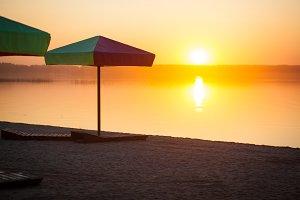 Beach umbrellas and sun loungers on