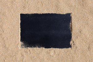 Blackboard on beach