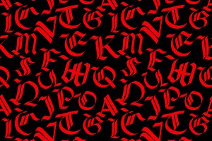 Old red gothic letters on black
