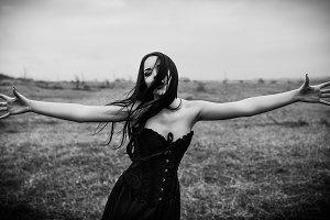 Crying sad goth girl in field