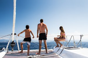 Friends sailing on a catamaran