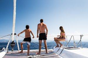 Friends sailing on a catamaran
