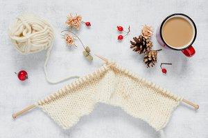 White knitting and red mug