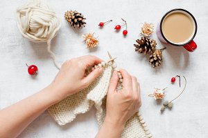 Female hands knit