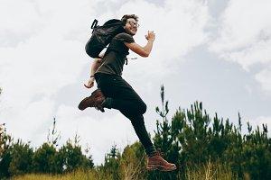 Happy man jumping during his walk