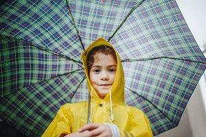 Cute little girl in raincoat