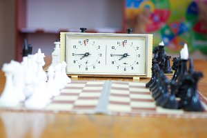 Clock and chessboard. The arranged c