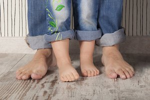 Father and daughter barefoot