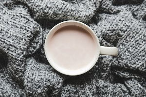 A cup of hot cocoa with milk