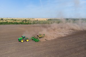 Sowing of winter wheat tractor from