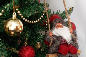 Christmas tree with toys and Santa C