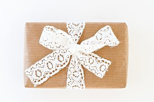 gift box with a white ribbon and bow