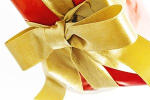 Gift red box with gold ribbon and bo
