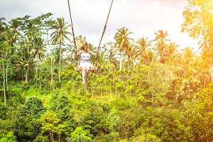 Young tourist woman swinging on the