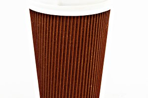 brown cardboard coffee glass with li