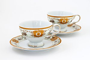 vintage tea set with gold decor isol