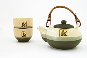 Chinese tea set with cups of tea iso