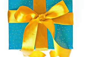 blue and yellow Christmas gift with