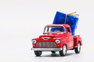 red retro car pickup with a blue gif