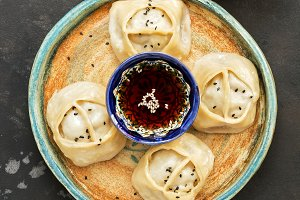 Asian steam manti dumplings with soy