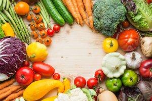 Summer vegetables on white table