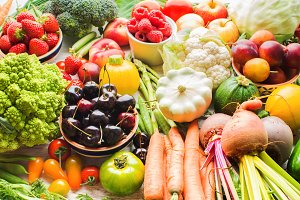 Summer fruits vegetables on table