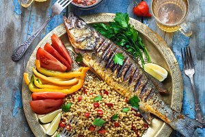 Grilled sea bass with ptitim and
